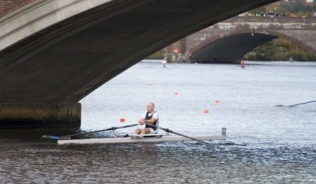 sculling: BOSTON - OCTOBER 18: In the Head of Charles Regatta, On October 18th, 2008 Racer  Sean Maloney of Bair Island Aquatic Club races to pass under the Weeks Footbridge finishing 32nd.