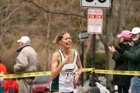 heartbreak: Boston, Ma 04 20 2009 Lori Kingsley races up Heartbreak Hill during the Boston Marathon in mock pain.JPG