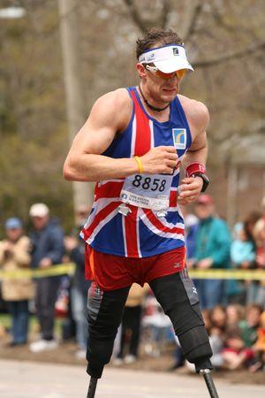 BOSTON- APRIL 20: Crowd cheer Richard Whitehead as he races up Heartbreak Hill during the Boston Marathon April 20, 2009 in Boston. Deriba Merga (Ethiopia) won the 113th edition marathon with 2:08:42.