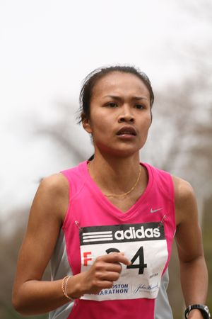 Boston, Ma 04 20 2009 Pacharee  Chaitongsri races up Heartbreak Hill during the Boston Marathon