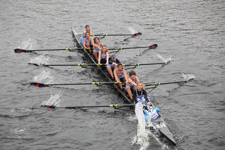 sculling: BOSTON - OCTOBER 24: The Riverside Boat Club puts her hand in the water to make a hard turn to starboard during the Head of the Charles Regatta  on October 24, 2010 in Boston, Massachusetts.