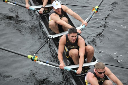 boat crew: BOSTON - OCTOBER 24: West Point Military Academy  mens Crew competes in the Head of the Charles Regatta on October 24, 2010 in Boston, Massachusetts.  Editorial