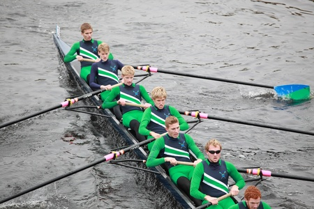 sculling: BOSTON - OCTOBER 24: New Trier High School Rowing Men 18 and Under mens Crew competes in the Head of the Charles Regatta on October 24, 2010 in Boston, Massachusetts.