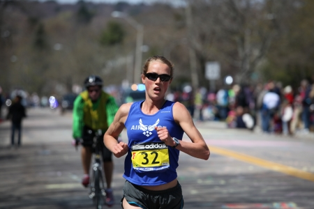 BOSTON - APRIL 18: Caroline White  races up the Heartbreak Hill during the Boston Marathon April 18, 2011 in Boston. Caroline Kilel (Kenya) won the womens category with 2:22:36.