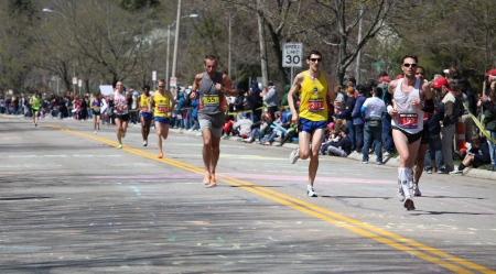 BOSTON - APRIL 18 : Nearly 25000 runners participated in the Boston Marathon on April 18, 2011 in Boston. Geoffrey Mutai (Kenya) finished first with a time of 2:03:02.  Editorial