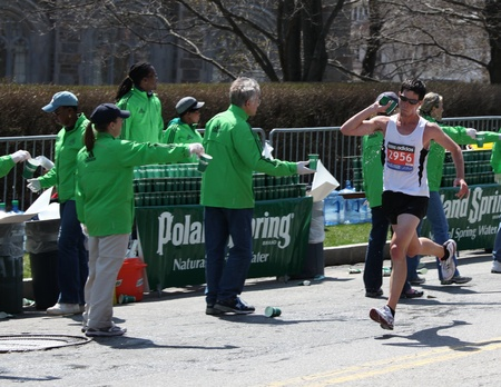 BOSTON - APRIL 18 : Volunteers gave water to runners during the Boston Marathon on April 18, 2011 in Boston. Geoffrey Mutai (Kenya) finished first with a time of 2:03:02.  Editorial