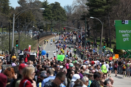 BOSTON - APRIL 18 : Fans cheer and encourage runners during the Boston Marathon on April 18, 2011 in Boston. Geoffrey Mutai (Kenya) finished first with a time of 2:03:02.  Editorial