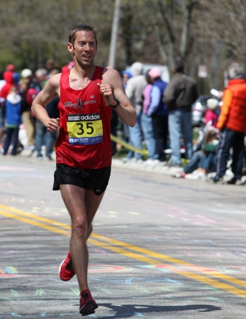 BOSTON - APRIL 18 : Nearly 25000 runners participated in the Boston Marathon on April 18, 2011 in Boston. Geoffrey Mutai (Kenya) finished first with a time of 2:03:02.