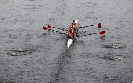 university of wisconsin: BOSTON - OCTOBER 23: University of Wisconsin Mens Fours races in the Head of Charles Regatta on winning with a time of 16:12 on October 23, 2011 in Boston, MA.