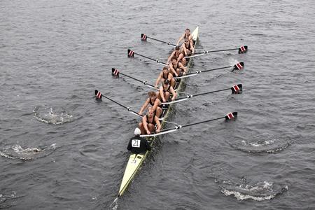 northeastern: BOSTON - OCTOBER 23: Northeastern University races in the Head of Charles Regatta, Harvard University won with a with a time of 14:17 on October 23, 2011 in Boston, MA.