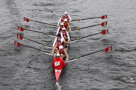 eights: BOSTON - OCTOBER 23: Community Rowing youth men Eights races in the Head of Charles Regatta. Marin Rowing Association won with a time of 15:06 on October 23, 2011 in Boston, MA.