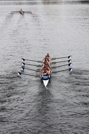 BOSTON - OCTOBER 23: Everett Rowing youth men Eights races in the Head of Charles Regatta. Marin Rowing Association won with a time of 15:06 on October 23, 2011 in Boston, MA.