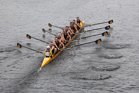 BOSTON - OCTOBER 23: Saint Ignatius High School - Cleveland youth men Eights races in the Head of Charles Regatta. Marin Rowing Association won with a time of 15:06 on October 23, 2011 in Boston, MA. Editorial