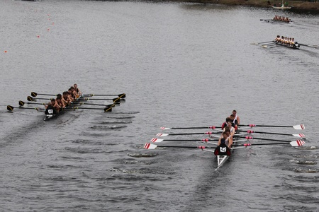 eights: BOSTON - OCTOBER 23: San Diego Rowing Club youth men Eights races in the Head of Charles Regatta. Marin Rowing Association won with a time of 15:06 on October 23, 2011 in Boston, MA.