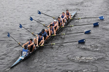 BOSTON - OCTOBER 23: Shaker Rowing Association youth men Eights races in the Head of Charles Regatta. Marin Rowing Association won with a time of 15:06 on October 23, 2011 in Boston, MA.
