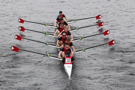 eights: BOSTON - OCTOBER 23: St. Johns High School Crew youth men Eights races in the Head of Charles Regatta. Marin Rowing Association won with a time of 15:06 on October 23, 2011 in Boston, MA.