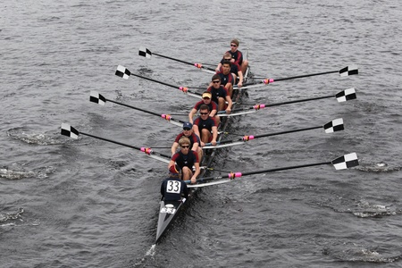 BOSTON - OCTOBER 23: Tbc Racing youth men Eights races in the Head of Charles Regatta. Marin Rowing Association won with a time of 15:06 on October 23, 2011 in Boston, MA.
