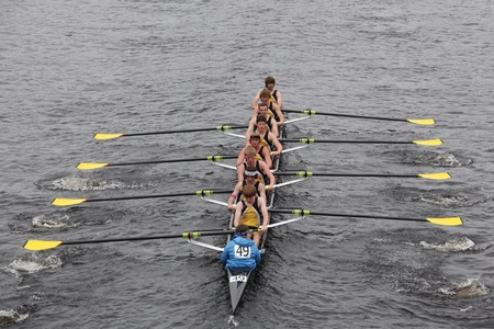 eights: BOSTON - OCTOBER 23: Upper Arlington Crew youth men Eights races in the Head of Charles Regatta. Marin Rowing Association won with a time of 15:06 on October 23, 2011 in Boston, MA.