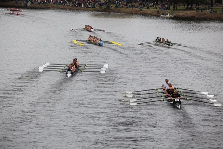 eights: BOSTON - OCTOBER 23: Many teams in youth mens Eights race in the Head of Charles Regatta. Marin Rowing Association won with a time of 15:06 on October 23, 2011 in Boston, MA. Editorial