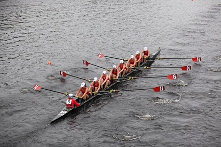 BOSTON - OCTOBER 23: Community Rowing youth womens Eights races in the Head of Charles Regatta. Oakland Strokes won with a time of 17:12 on October 23, 2011 in Boston, MA.