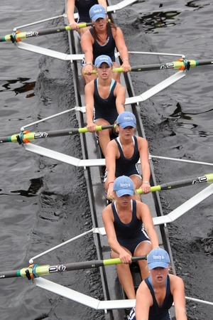 BOSTON - OCTOBER 23: Saratoga Rowing Association youth womens Eights races in the Head of Charles Regatta. Oakland Strokes won with a time of 17:12 on October 23, 2011 in Boston, MA. 報道画像