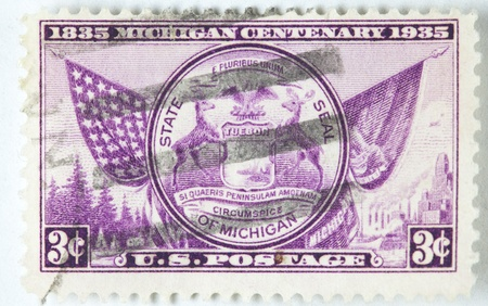 A stamp printed by USA shows the state of Michigan Centenary , circa 1936.  photo