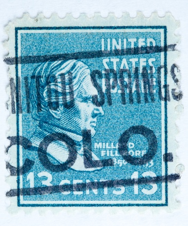 colo: UNITED STATES - CIRCA 1938   A stamp printed in United States  Displays the profile of President Millard Fillmore with a post mark from Manatou Springs Colorado  United States - circa 1938
