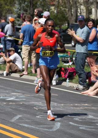 BOSTON - APRIL 16 : Jeptoo (Kenya) races up Heartbreak Hill during the Boston Marathon on a hot 87 degree day on April 16, 2011 in Boston. Sharon Cherop (Kenya) finished first with a time of 2:30:50.  Stock Photo - 13257613