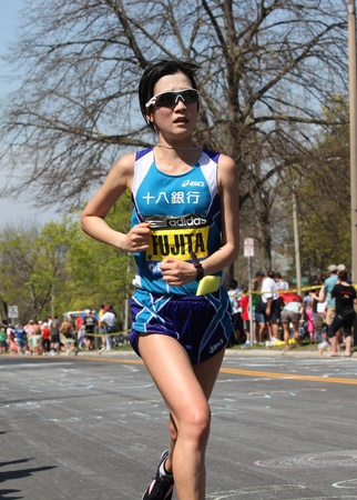 BOSTON - APRIL 16: Mayumi Fujita (Japan) races up Heartbreak Hill during the Boston Marathon on April 16, 2011 in Boston. Sharon Cherop (Kenya) finished first with a time of 2:30:50.  Stock Photo - 13257610