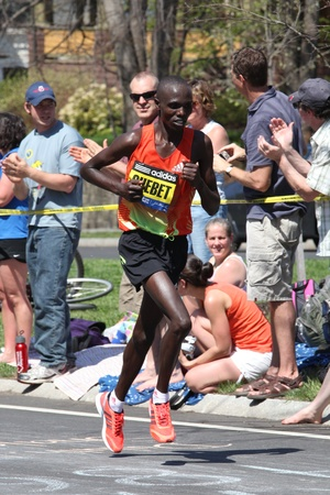 BOSTON - APRIL 16: Wilson Chebet races up Heartbreak Hill during the Boston Marathon on a hot 87 degree day on April 16, 2011 in Boston. Korir, Wesley (Kenya) finished first with a time of 2:12:40.  Stock Photo - 13257609