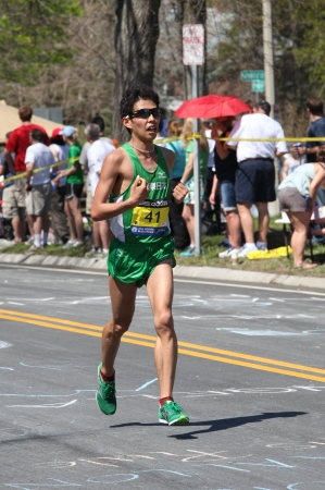 heartbreak: BOSTON - APRIL 16: Tamura Hideaki (Japan) races up Heartbreak Hill during the Boston Marathon on April 16, 2011 in Boston. Korir, Wesley (Kenya) finished first with a time of 2:12:40.