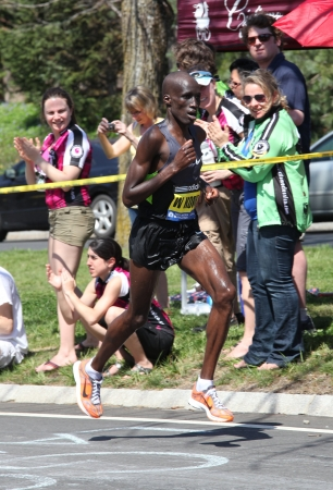 wesley: BOSTON - APRIL 16: Wesley Korir (Kenya)races up Heartbreak Hill during the Boston Marathon on a hot 87 degree day on April 16, 2011 in Boston. He finished first with a time of 2:12:40.