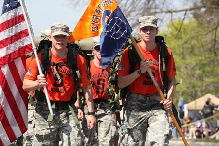 lb: BOSTON - APRIL 16 : Fans cheer on Syracuse ROTC marching the boston marathon in full 40 lb ruck-sacks during the Boston Marathon April 16, 2012 in Boston.  Editorial