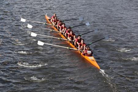 BOSTON - OCTOBER 21 Loyola Academy races in the Head of Charles Regatta, Marin Rowing Association won with a with a time of 12:59 on October 21, 2012 in Boston, MA.  Editorial