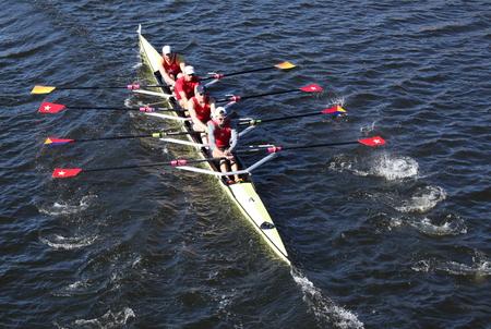 BOSTON - OCTOBER 20  Potomac Boat Club races in the Directors  Challenge Quad Men in the Head of Charles Regatta on October 20, 2013 in Boston, MA Editorial