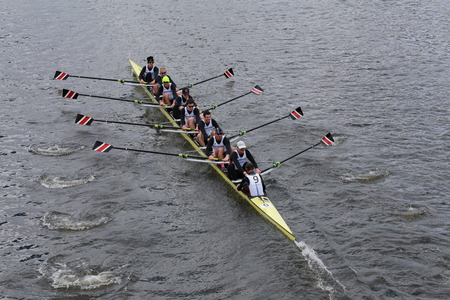 eights: BOSTON - OCTOBER 19, 2014: Northeastern University races in the Head of Charles Regatta Mens Championship Eights Editorial