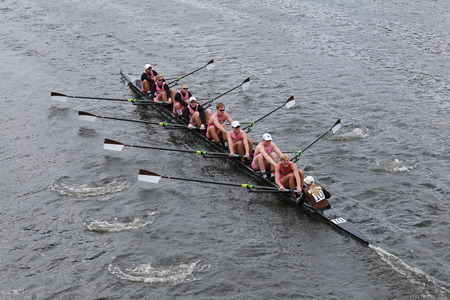 eights: BOSTON - OCTOBER 19, 2014: Brown University races in the Head of Charles Regatta Mens Championship Eights Editorial