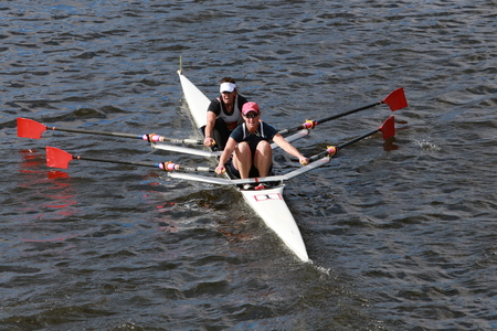BOSTON - OCTOBER 19, 2014:Lisa Schlenker Kelly Salchow MacArthur races in the Head of Charles Regatta womens Doubles Editorial