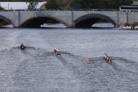 eights: BOSTON - OCTOBER 18, 2015: Marinleft, Saratogacenter,OKC Riversportright races in the Head of Charles Regatta Womens Youth Eights