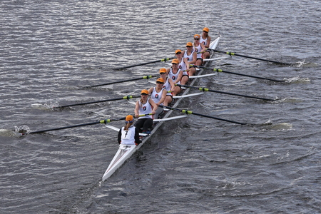 eights: BOSTON - OCTOBER 18, 2015: Oakland Strokes races in the Head of Charles Regatta Womens Youth Eights Editorial