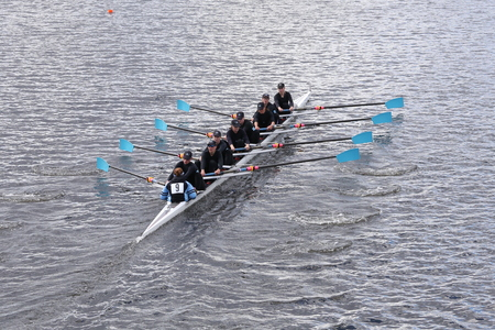 eights: BOSTON - OCTOBER 18, 2015: Vashon Island races in the Head of Charles Regatta Womens Youth Eights Editorial