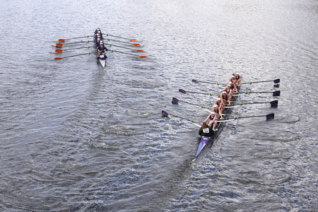 sculling: BOSTON - OCTOBER 18, 2015: Albany left and Mount Saint Joseph races in the Head of Charles Regatta Womens Youth Eights