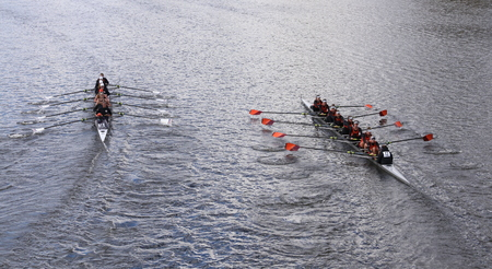 dominion: BOSTON - OCTOBER 18, 2015: Old Dominion left and Wayland-Weston right races in the Head of Charles Regatta Womens Youth Eights Editorial