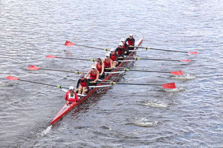 eights: BOSTON - OCTOBER 18, 2015: CRI races in the Head of Charles Regatta Womens Youth Eights Editorial