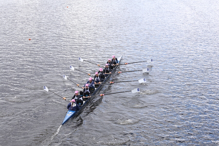 sculling: BOSTON - OCTOBER 18, 2015: Sarasota Crew races in the Head of Charles Regatta Womens Youth Eights Editorial