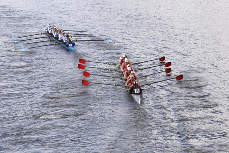 eights: BOSTON - OCTOBER 18, 2015: Bromfield Acton Boxboroughleft and Hingham High Schoolright races in the Head of Charles Regatta Womens Youth Eights Editorial