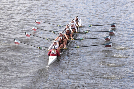 eights: BOSTON - OCTOBER 18, 2015: Holy Names Academy races in the Head of Charles Regatta Womens Youth Eights Editorial