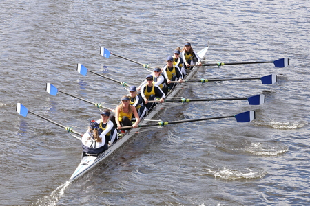 eights: BOSTON - OCTOBER 18, 2015: Long Beach Junior Crew races in the Head of Charles Regatta Womens Youth Eights Editorial