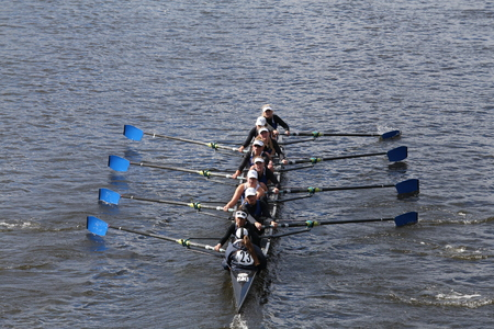 eights: BOSTON - OCTOBER 18, 2015: Milwaukee races in the Head of Charles Regatta Womens Youth Eights