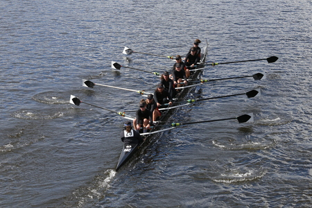 eights: BOSTON - OCTOBER 18, 2015: Rose City Rowing races in the Head of Charles Regatta Womens Youth Eights Editorial
